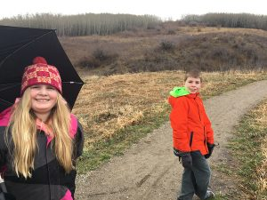 Nose hill with the kids - two guys in the woods