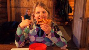 eating pizza at elk lakes cabin